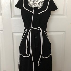 Stylish black dress with white trim